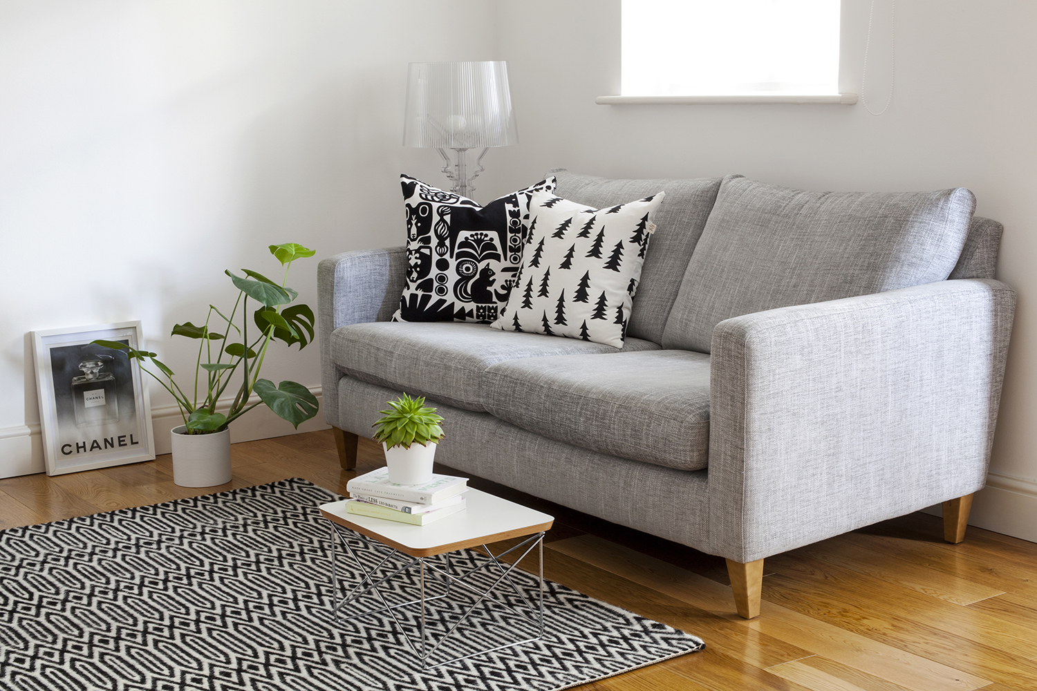 Decluttering My Home: My Journey to Minimalism | natashadenness.co.uk (photo of a living room with a grey sofa)