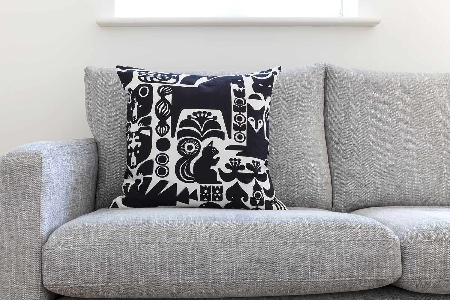 Decluttering My Home: My Journey to Minimalism | natashadenness.co.uk (photo of a grey sofa and cushion)