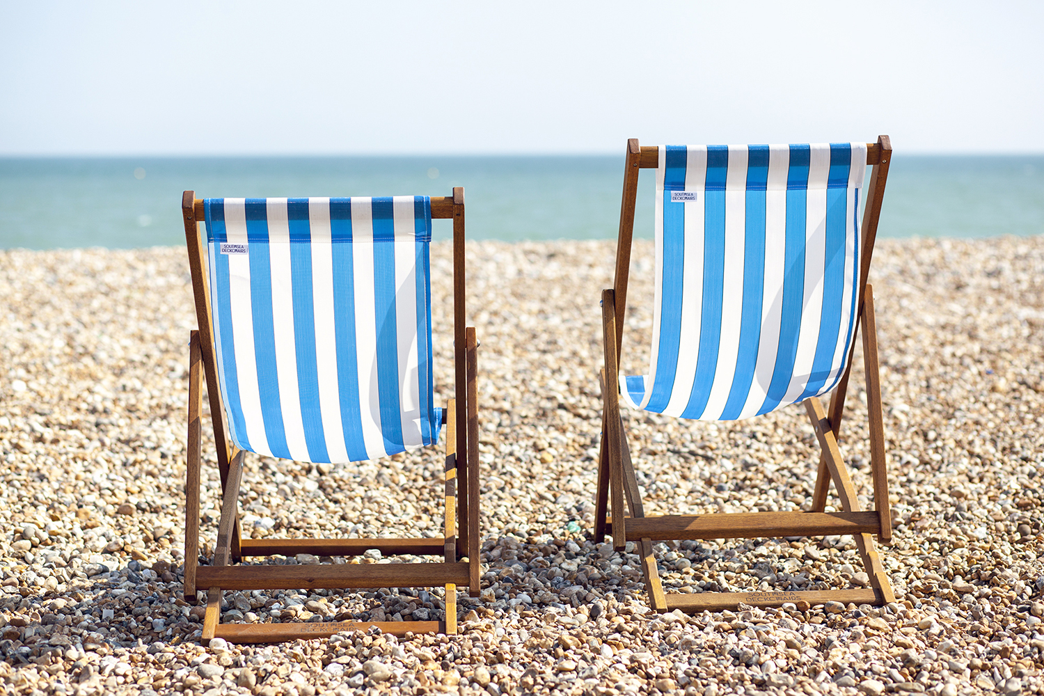 How 12 Busy Creatives like to Relax and Unwind | Natasha Denness Coaching (Photo of deck chairs on a beach)