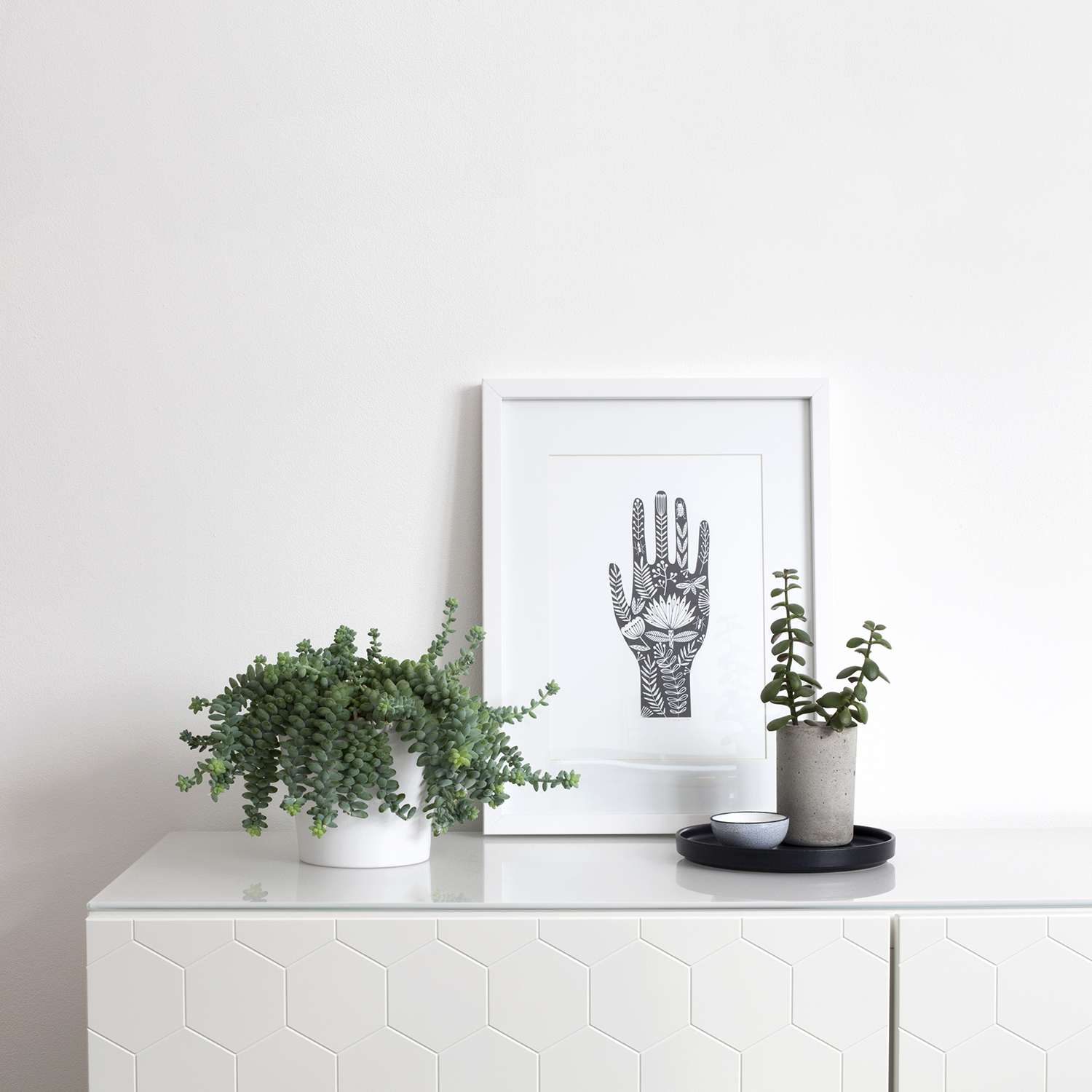 How to Set Digital Boundaries when you're Running a Creative Business | Natasha Denness Coaching | natashadenness.co.uk (photo of a sideboard with a picture and a plant)