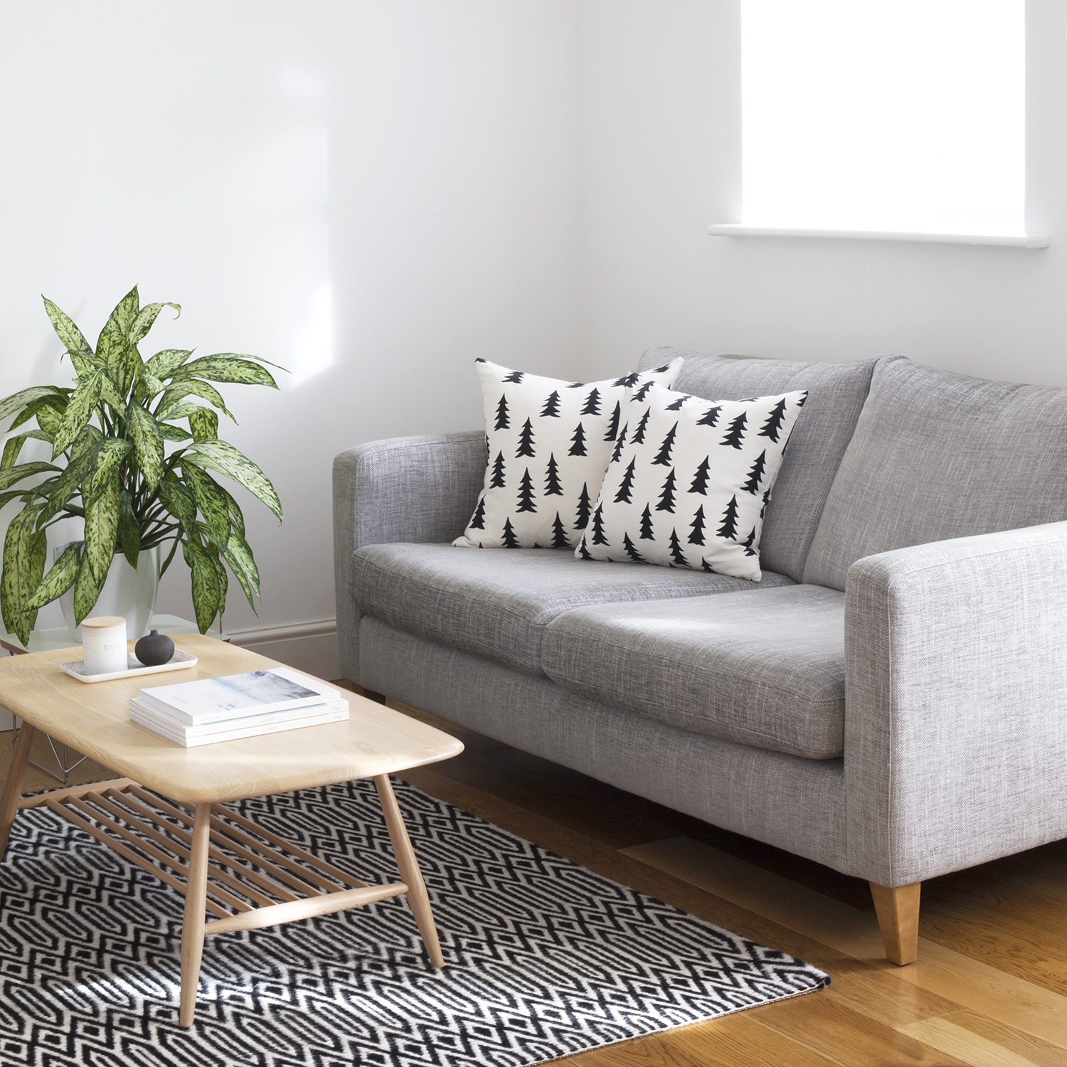 How to Set Digital Boundaries when you're Running a Creative Business | Natasha Denness Coaching | natashadenness.co.uk (Photo of a living room with a grey sofa)