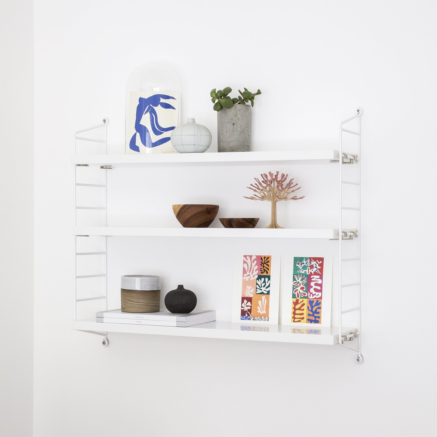 How to Maximise Your Space in a Small Home | Natasha Denness Coaching (Photo of a white display shelf)