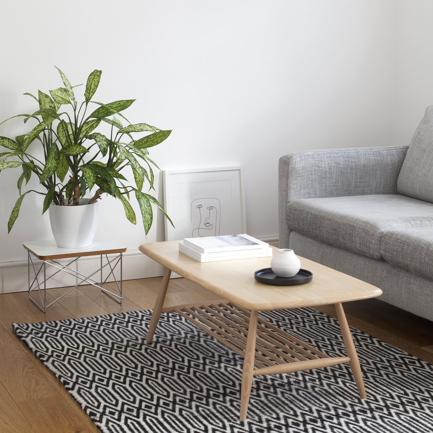 How to Maximise Your Space in a Small Home | Natasha Denness Coaching (photo of a living room with a grey sofa)
